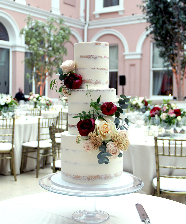 Semi Naked Wedding Cake with Pale & Deep Flowers