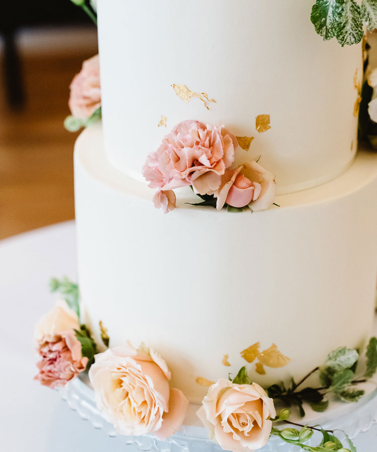 White Wedding Cake with Romantic Flowers Details