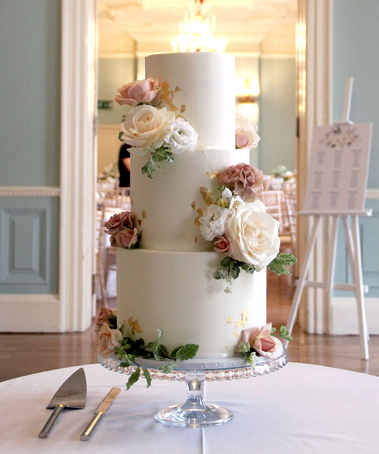 White Wedding Cake with Romantic Flowers