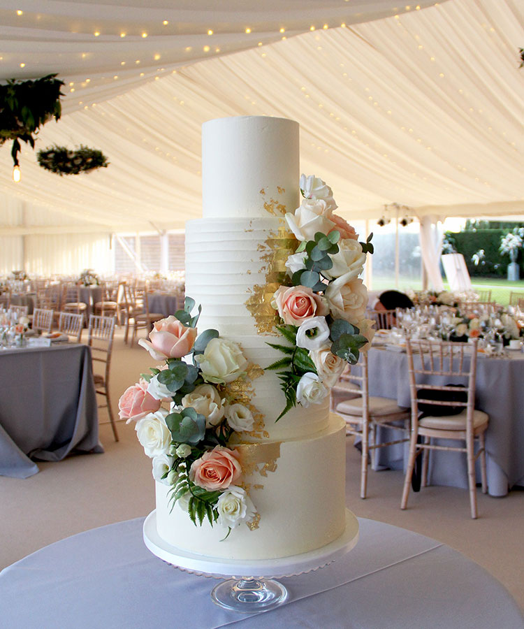 White Textured Wedding Cake with Heavy Gold & Peach Summer Flowers