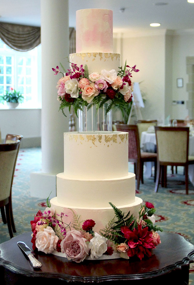 Clear Floating Rim Wedding Cake with Blush & Deep Flowers