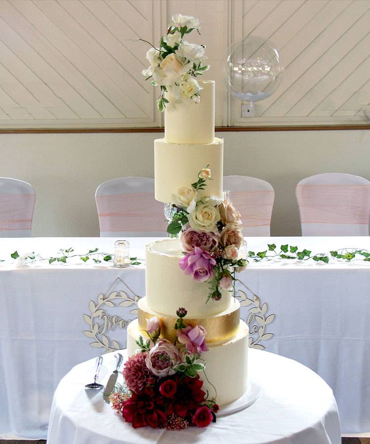 Side Floating Cake with Gold Tiers & Ombre Flowers