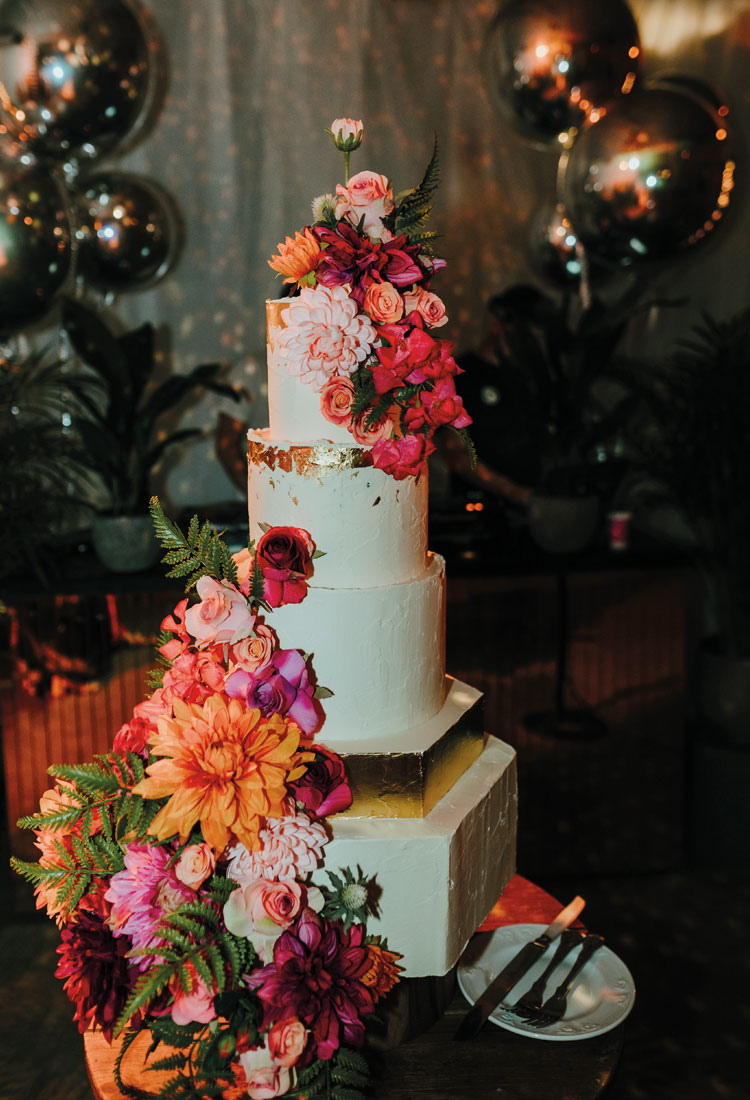 Hexagon Wedding Cake with a Gold Tier & Bright Flowers Full