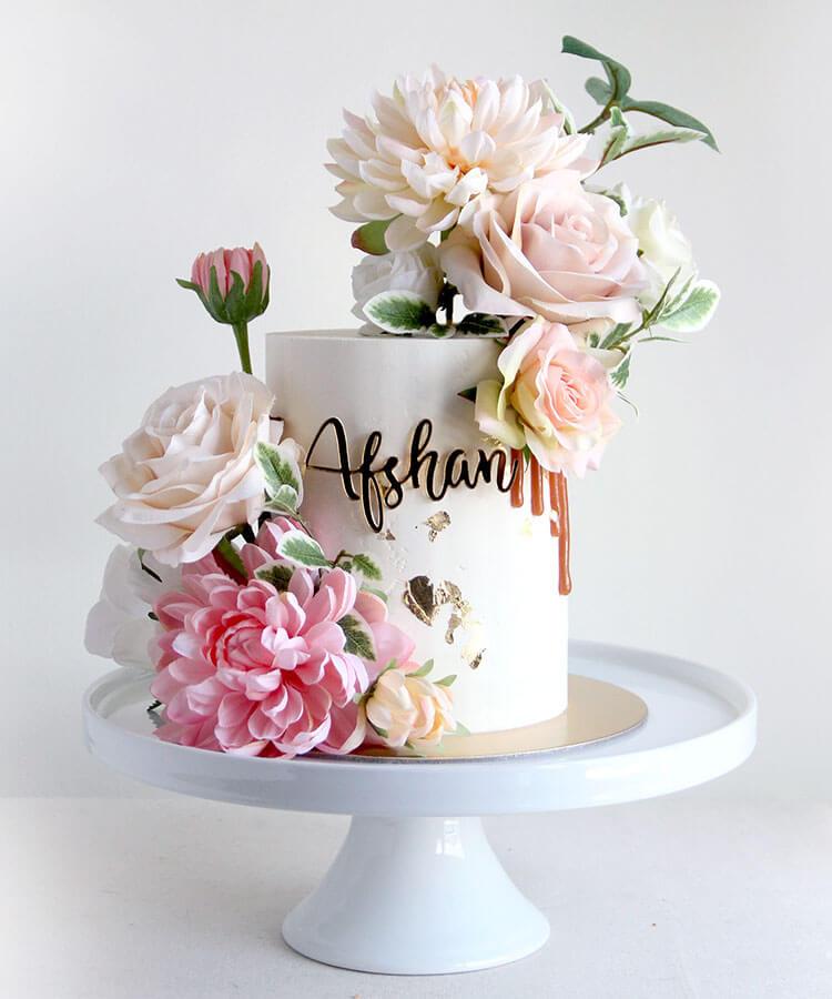 Pastel Flower Celebration Cake with Cake Charm