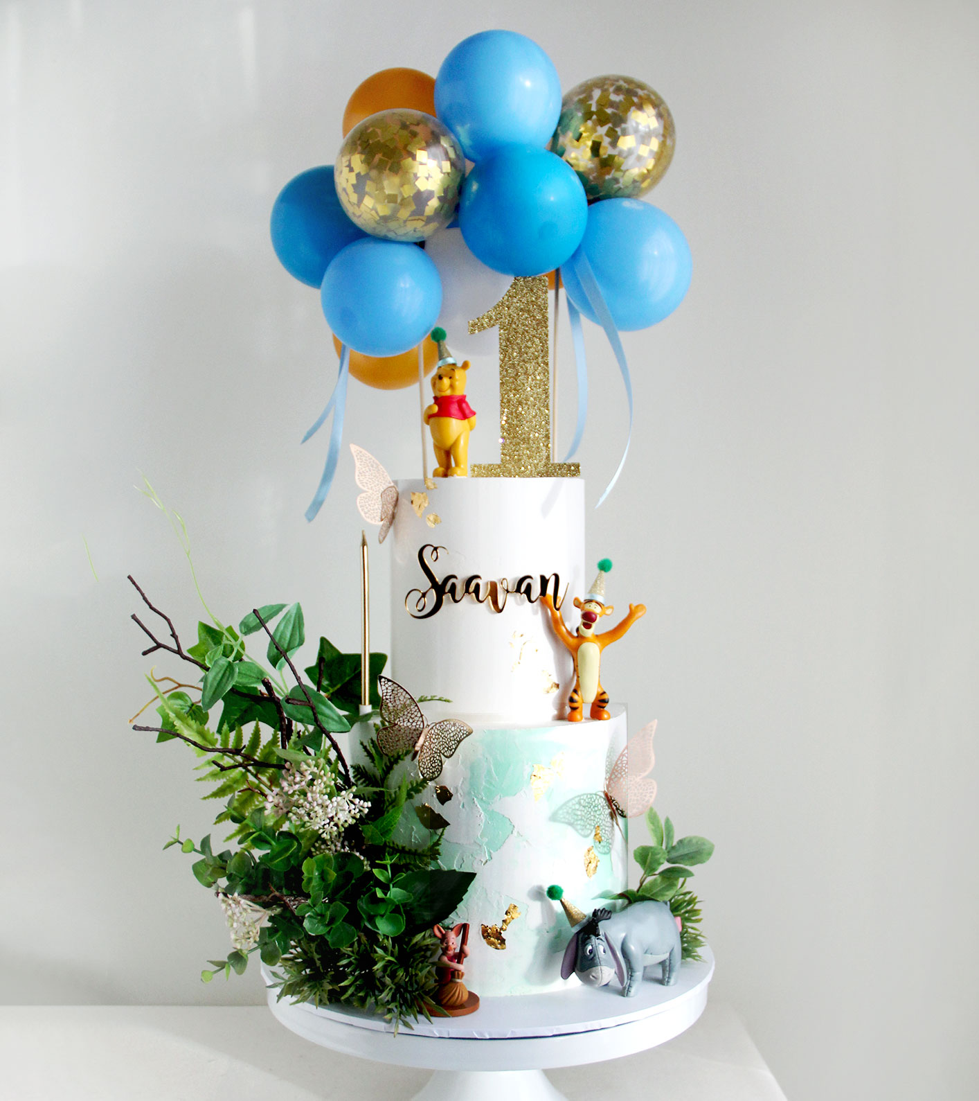2 Tier Character Cake with Foliage & Blue Balloons
