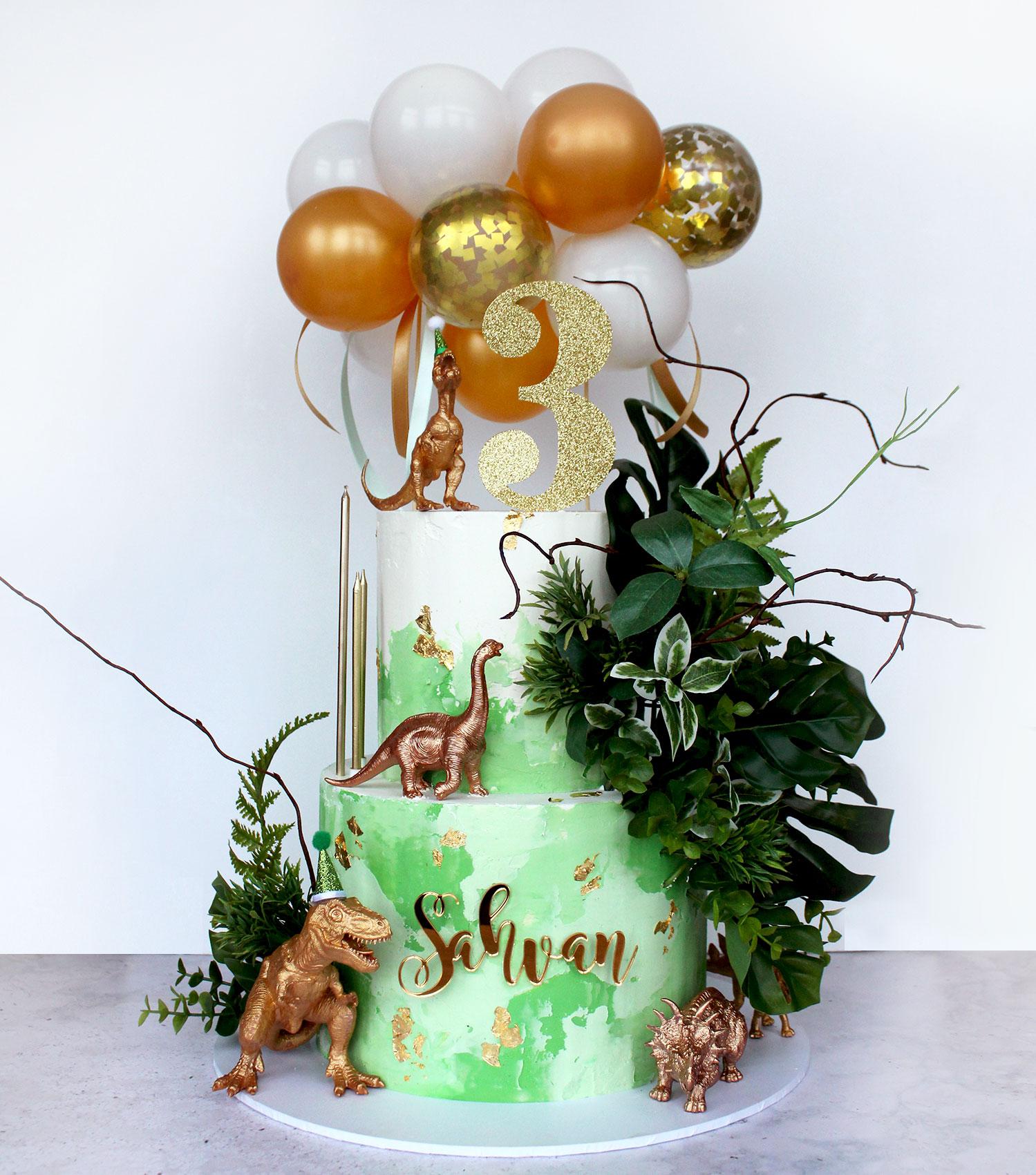 2 Tier Green & Gold Dinosaur Cake