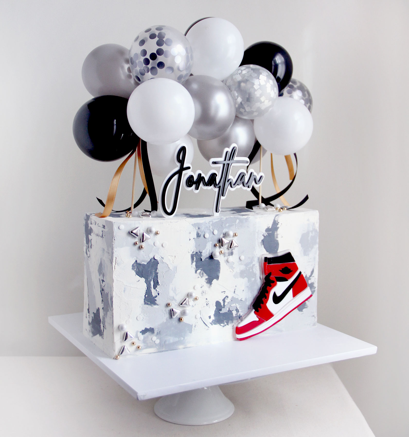 Watercolour Grey Wall Cake with Trainers & Balloons
